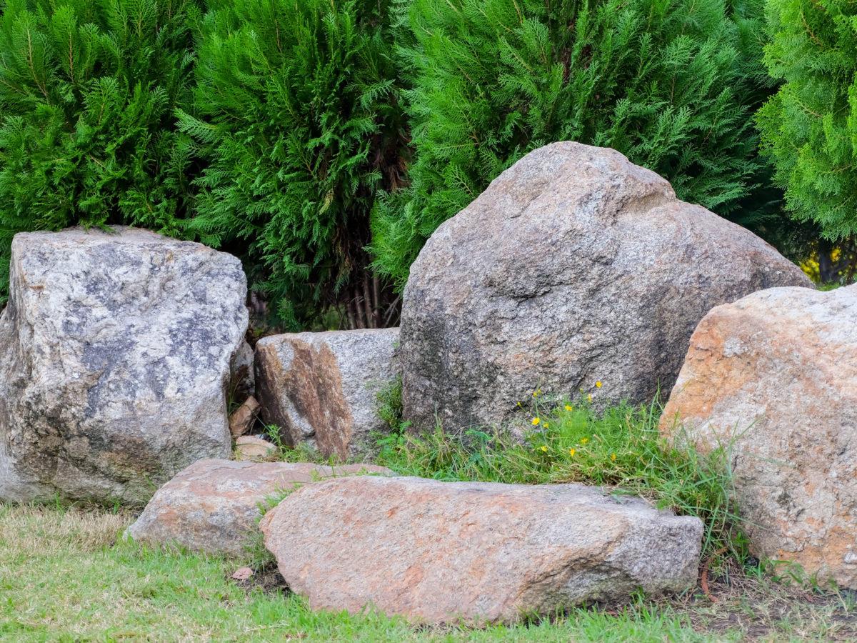 Round boulders next to landscaped grass