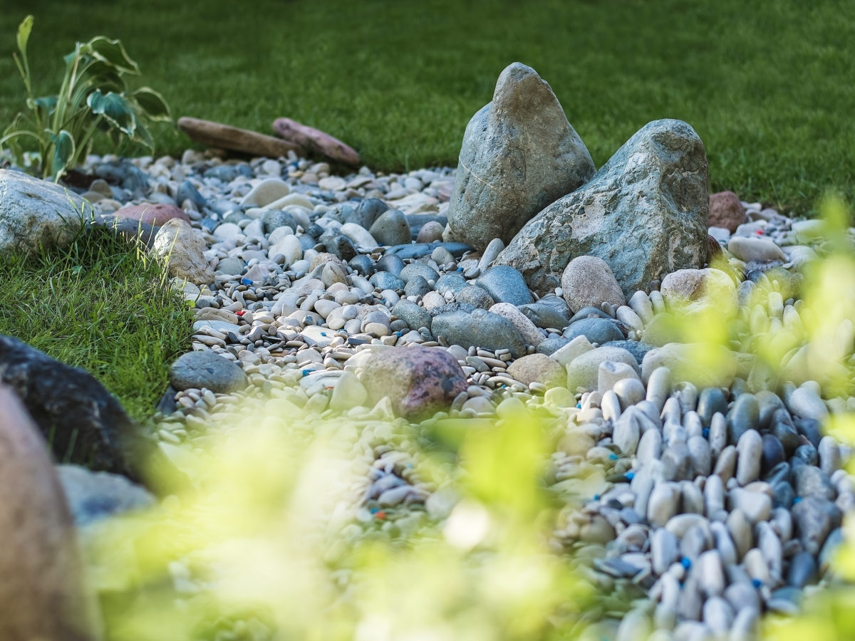 Boulder and pebble creek bed landscape rock project