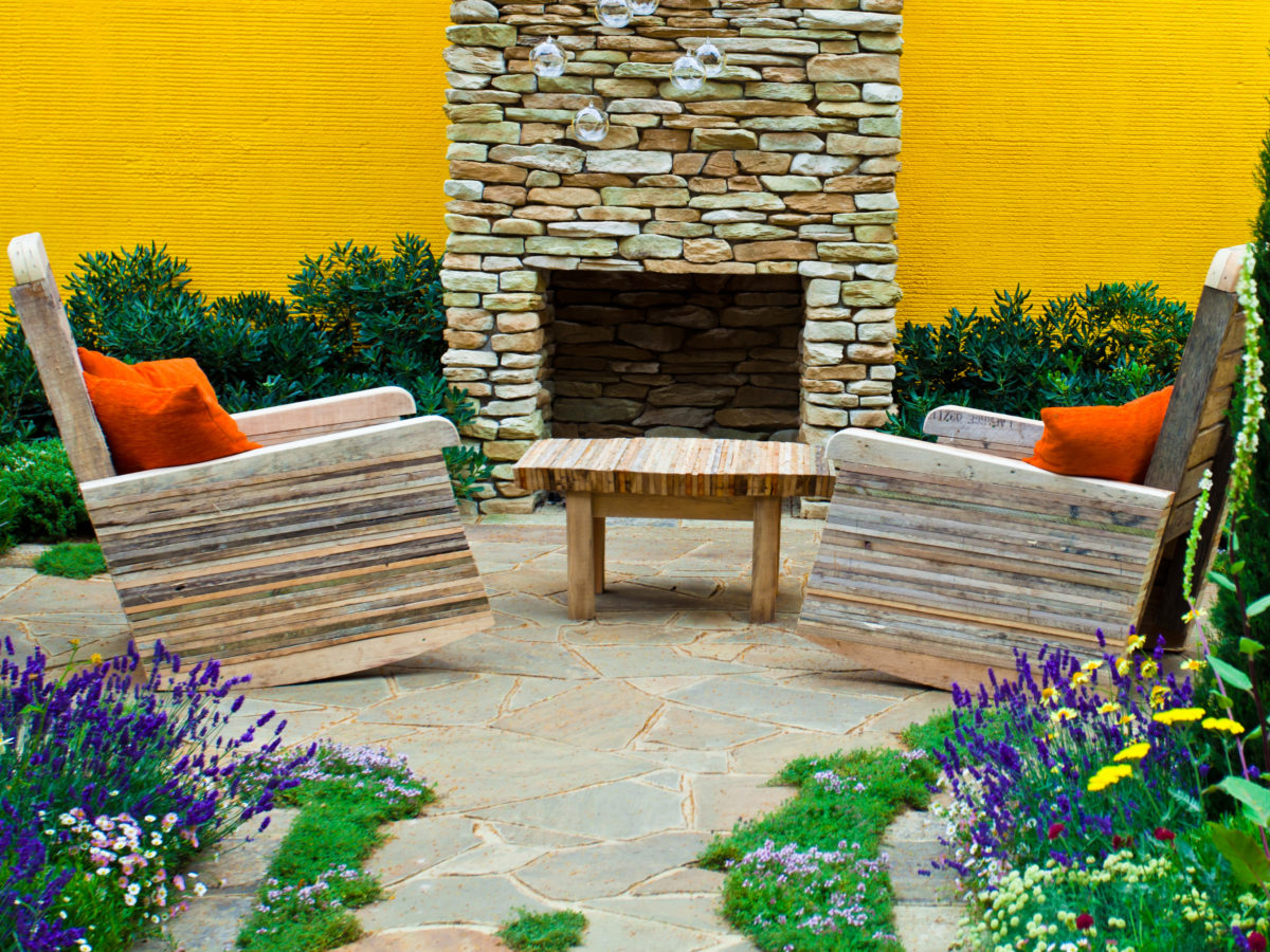 flagstone patio with fireplace and plants