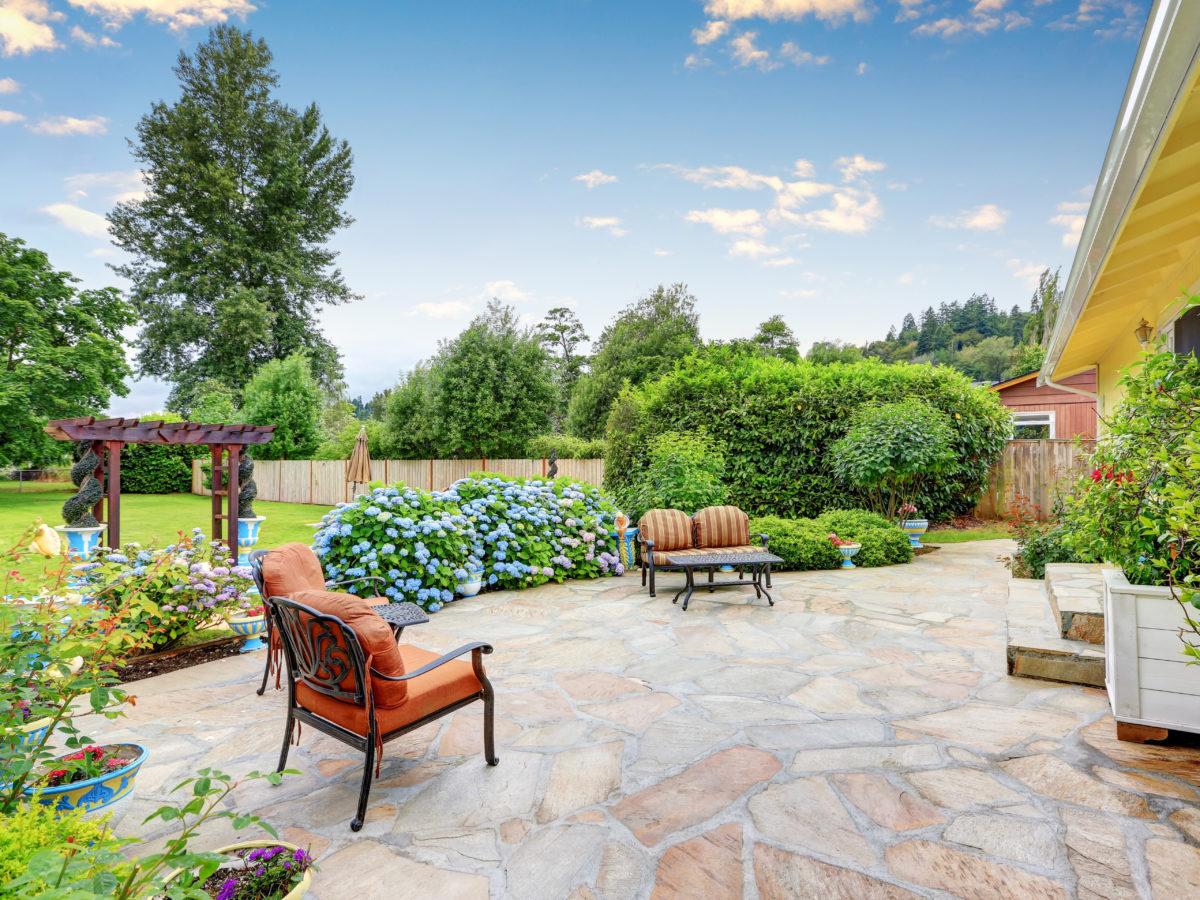 Backyard flagstone patio with furniture