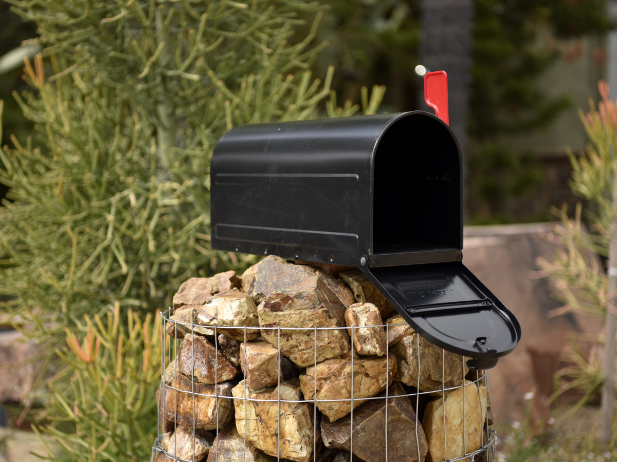 Gabion basket mailbox with crushed rock