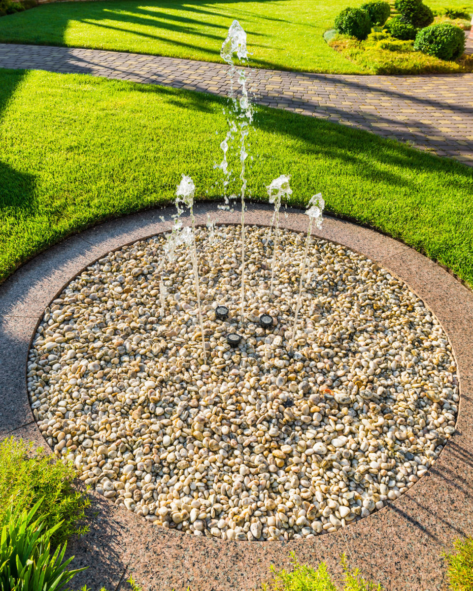 Crushed rock water fountain landscape rock projects in yard