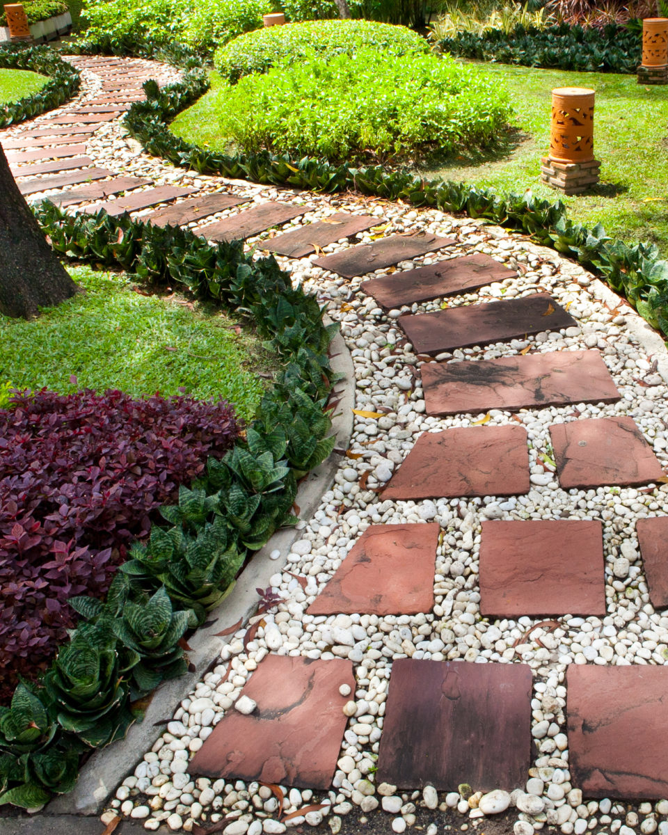 Stepping stone landscape rock project with pebbles in backyard