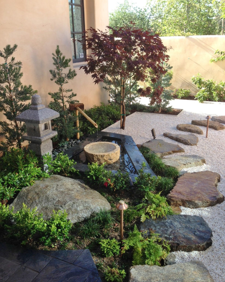 Backyard zen garden pathway with bamboo fountain and stepping stones