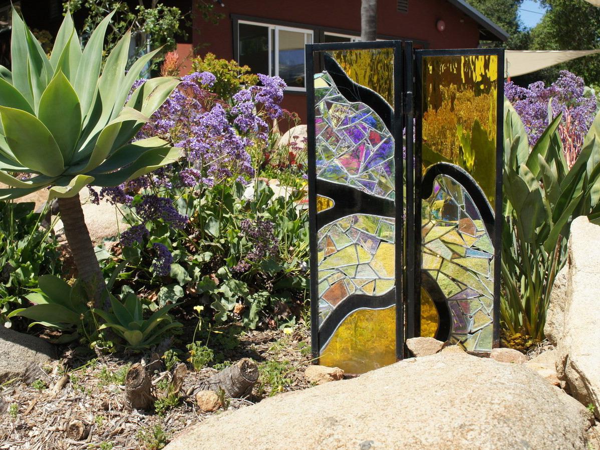 Glass art in mosaic rock garden