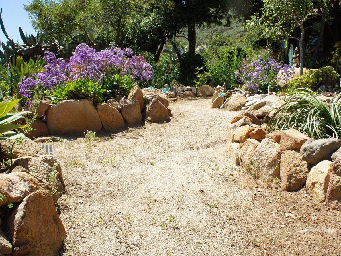 DG pathway with boulders in mosaic rock garden