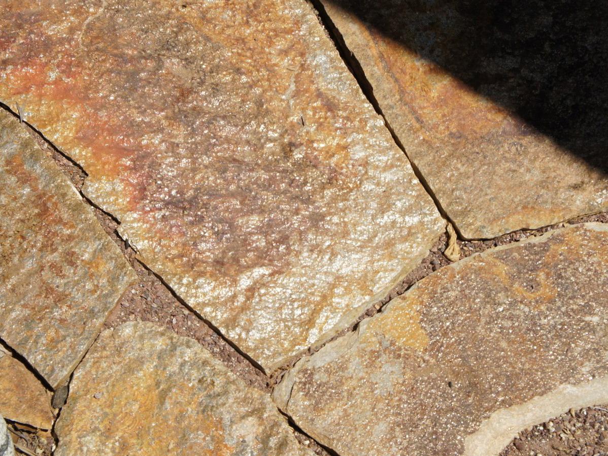 Flagstone patio in mosaic rock garden