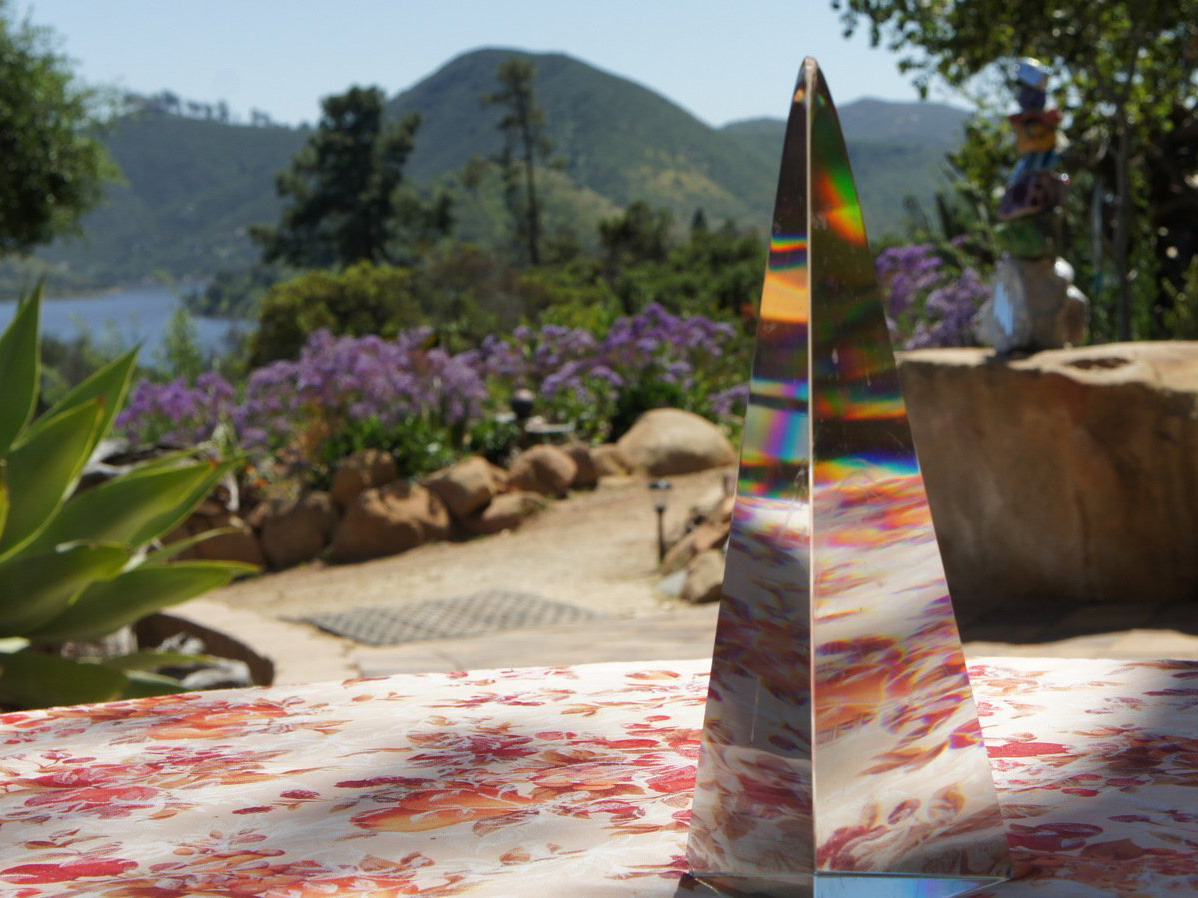 Glass piece on table in mosaic rock garden
