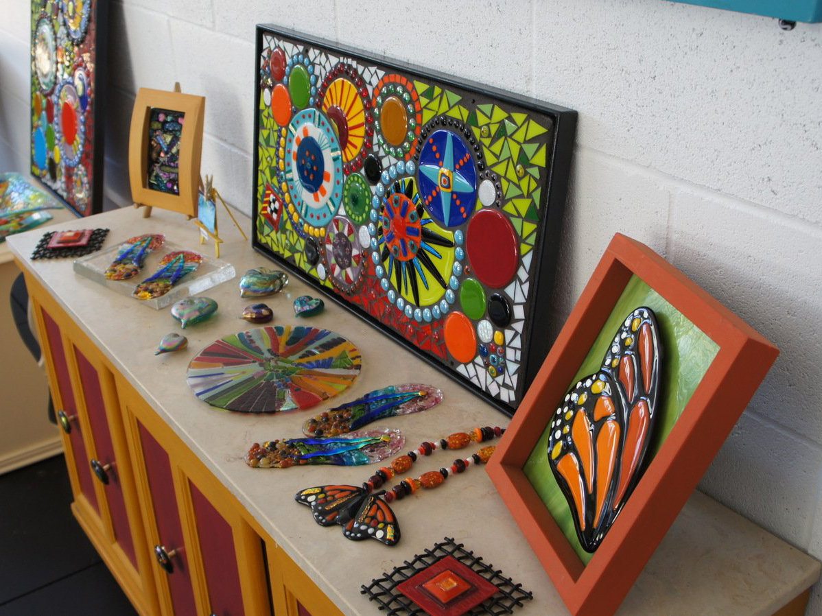 Mosaic rock art pieces on table