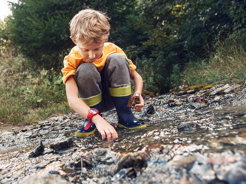 Creative landscape activities for kids building a dam 2